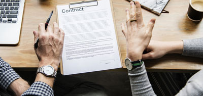 Two people disputing a contact prior to signing