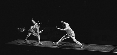 Two fencers opponents in battle