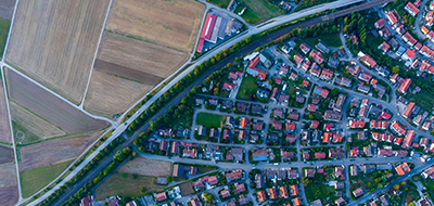 Aerial view of residential properties and vacant land