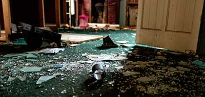 Smashed up property with glass broken and strun on the floor